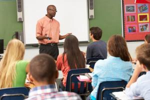 Teacher using interactive whiteboard during class